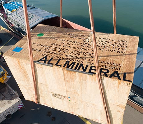 allmineral transport crate being set down at a harbour